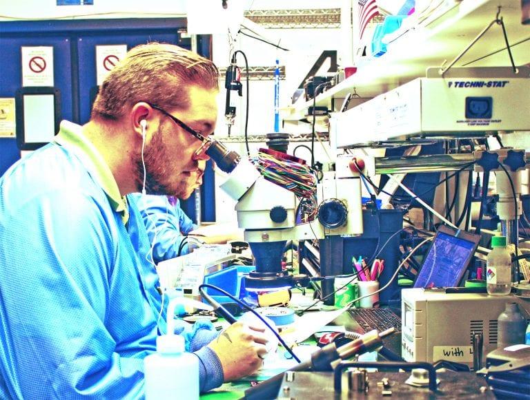 NuWaves Engineering manufacturing engineer working on CCA